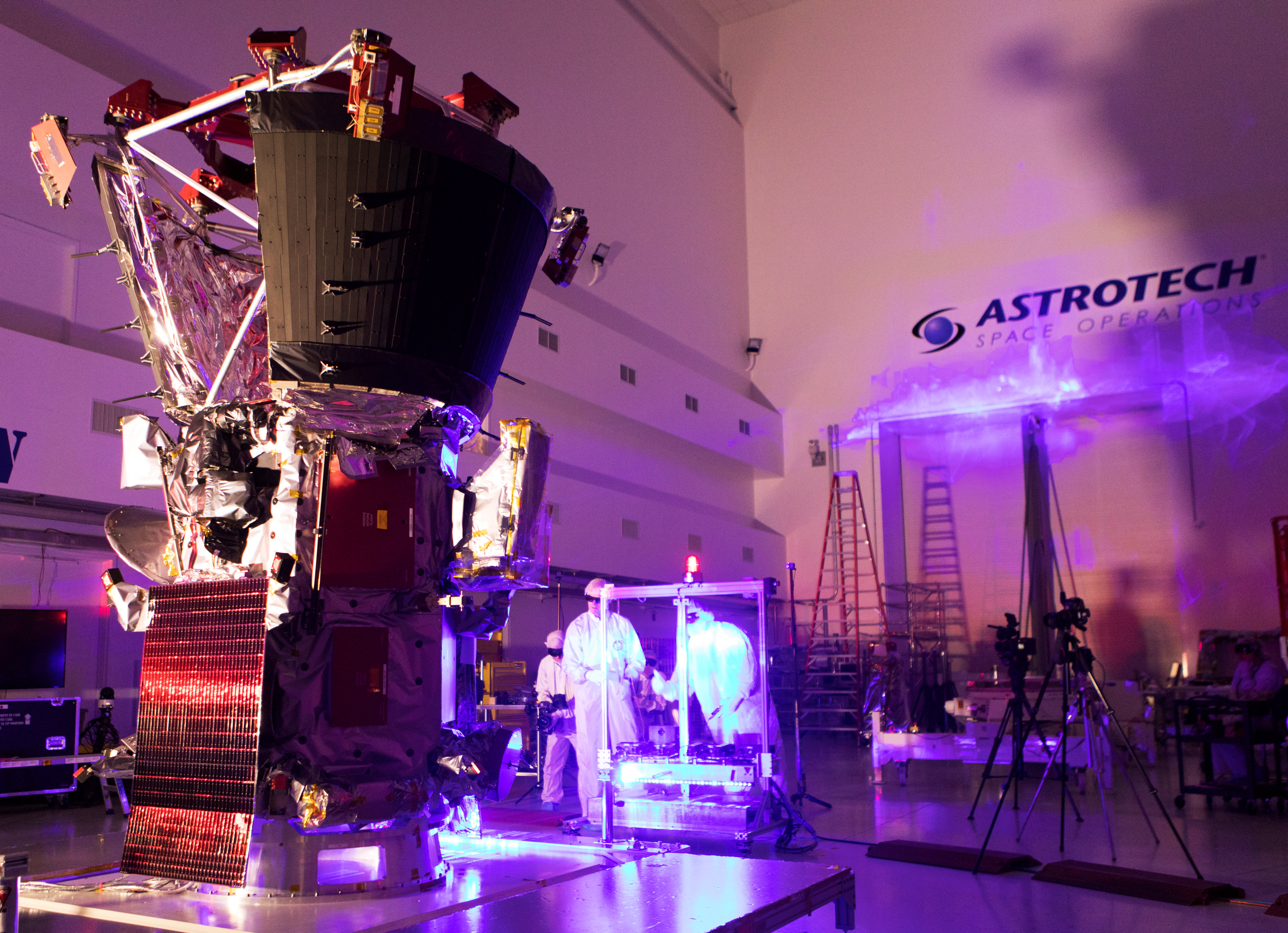 Technicians and engineers perform light bar testing on NASA's Parker Solar Probe in Titusville