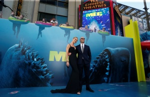 """Cast member Statham and model Huntington-Whiteley pose at the premiere for """"The Meg"""" in Los Angeles"""