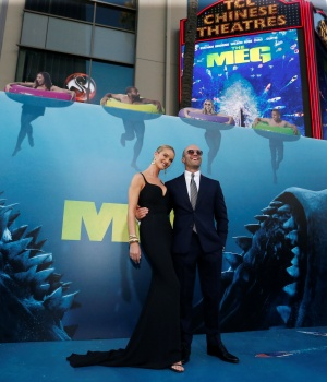 "Cast member Statham and model Huntington-Whiteley pose at the premiere for ""The Meg"" in Los Angeles"