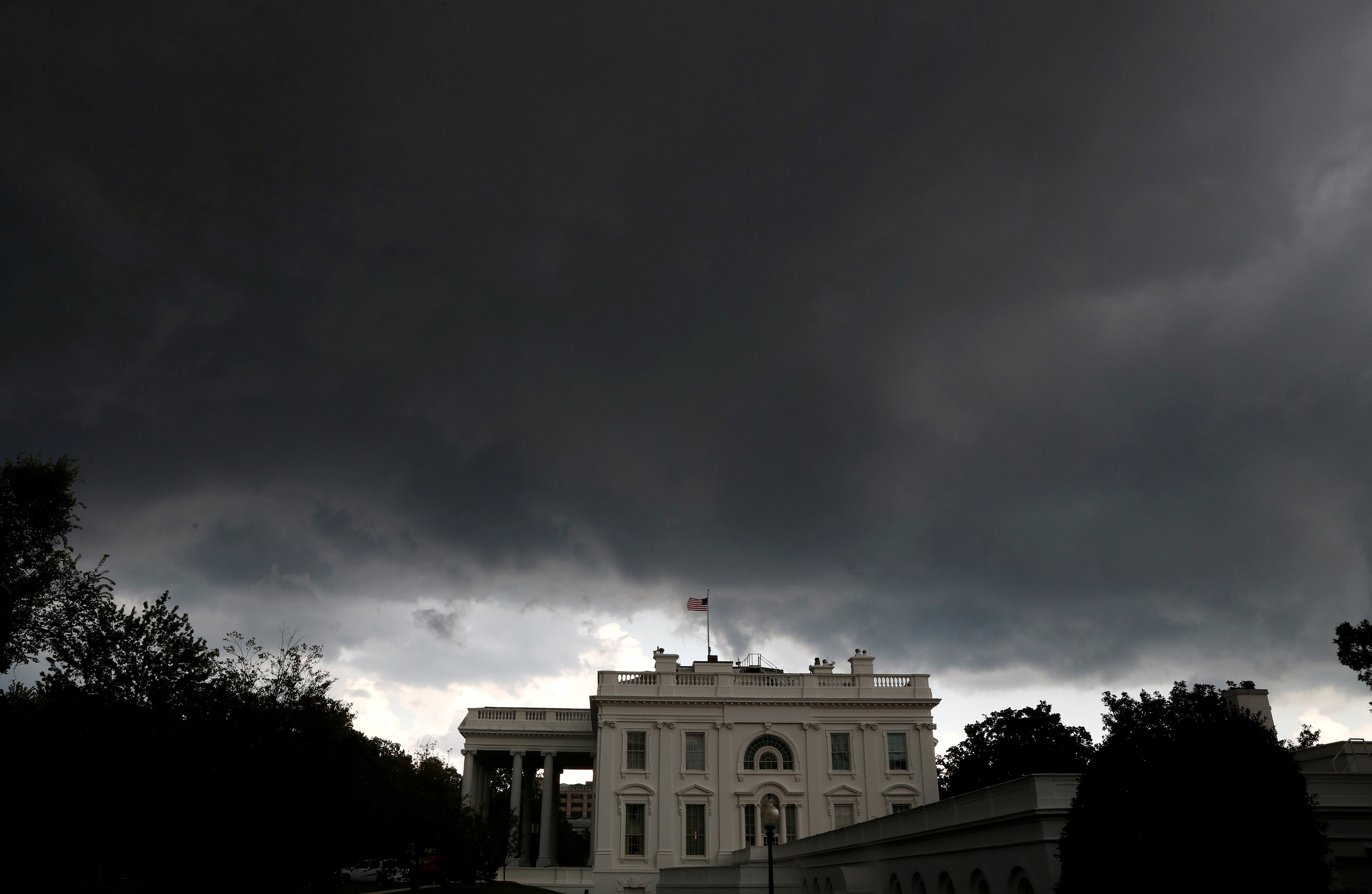 Storm clouds gather over the White House in Washington, D.C.