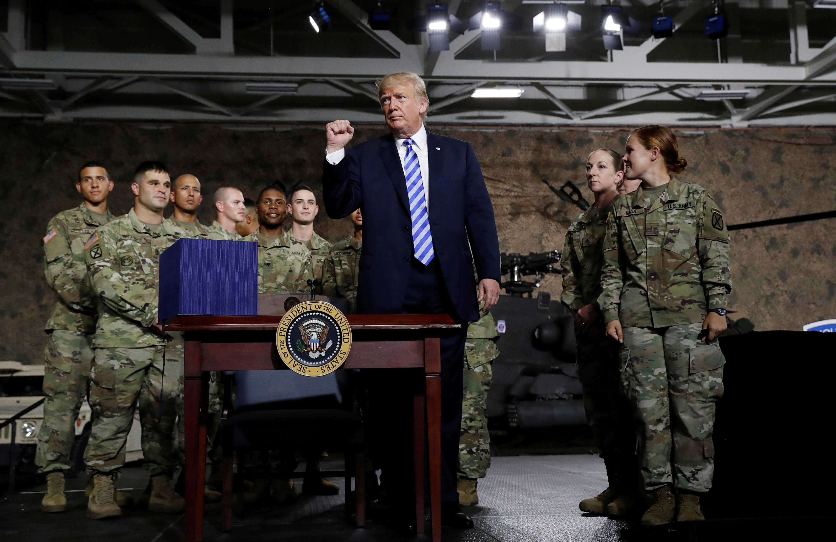 U.S. President Trump pumps fist after signing National Defense Authorization Act at Fort Drum, New York