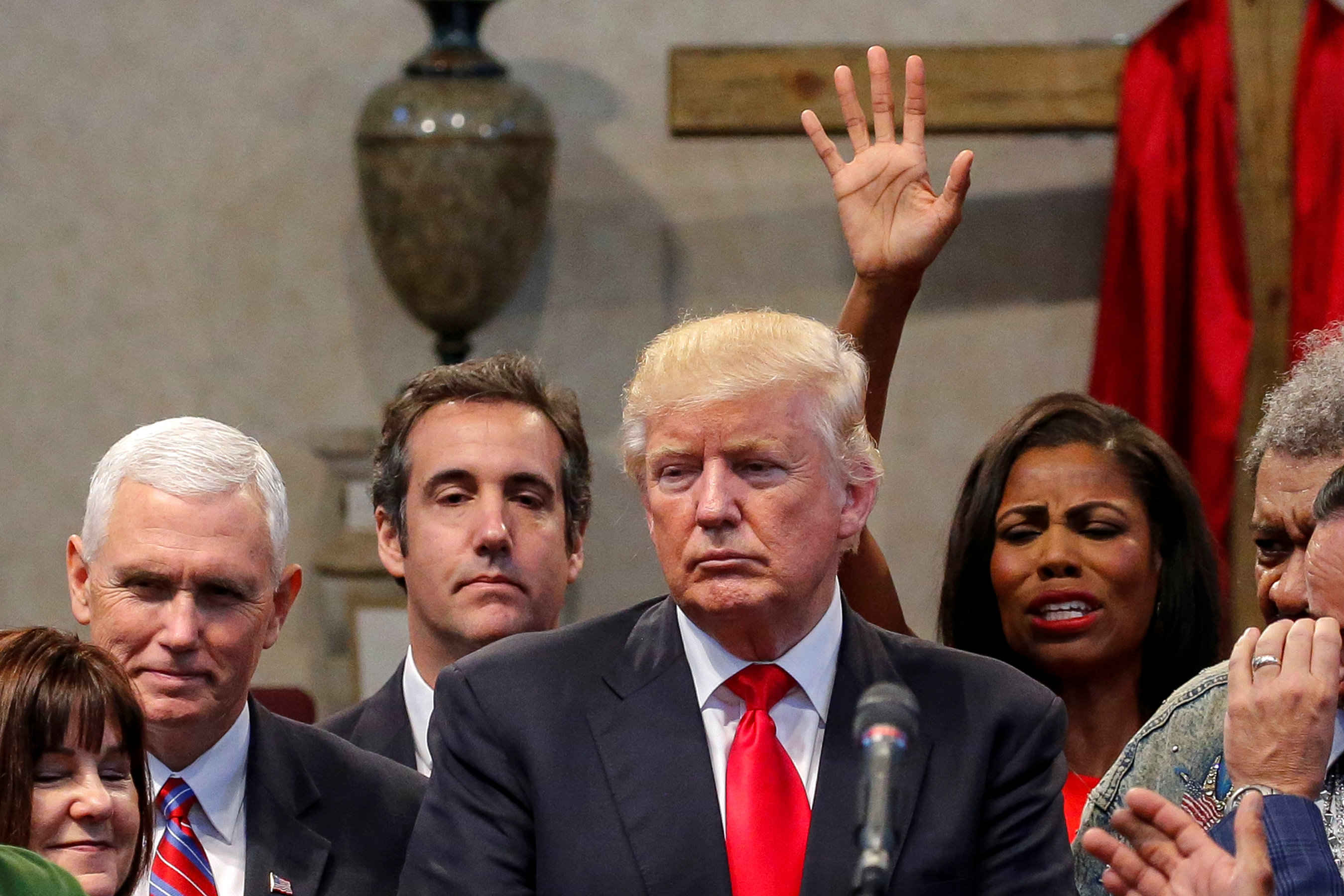 Cohen joins supporters praying over Trump during campaign stop at the New Spirit Revival Center church in Cleveland Heights, Ohio