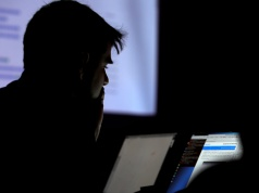 A man takes part in a hacking contest during the Def Con hacker convention in Las Vegas