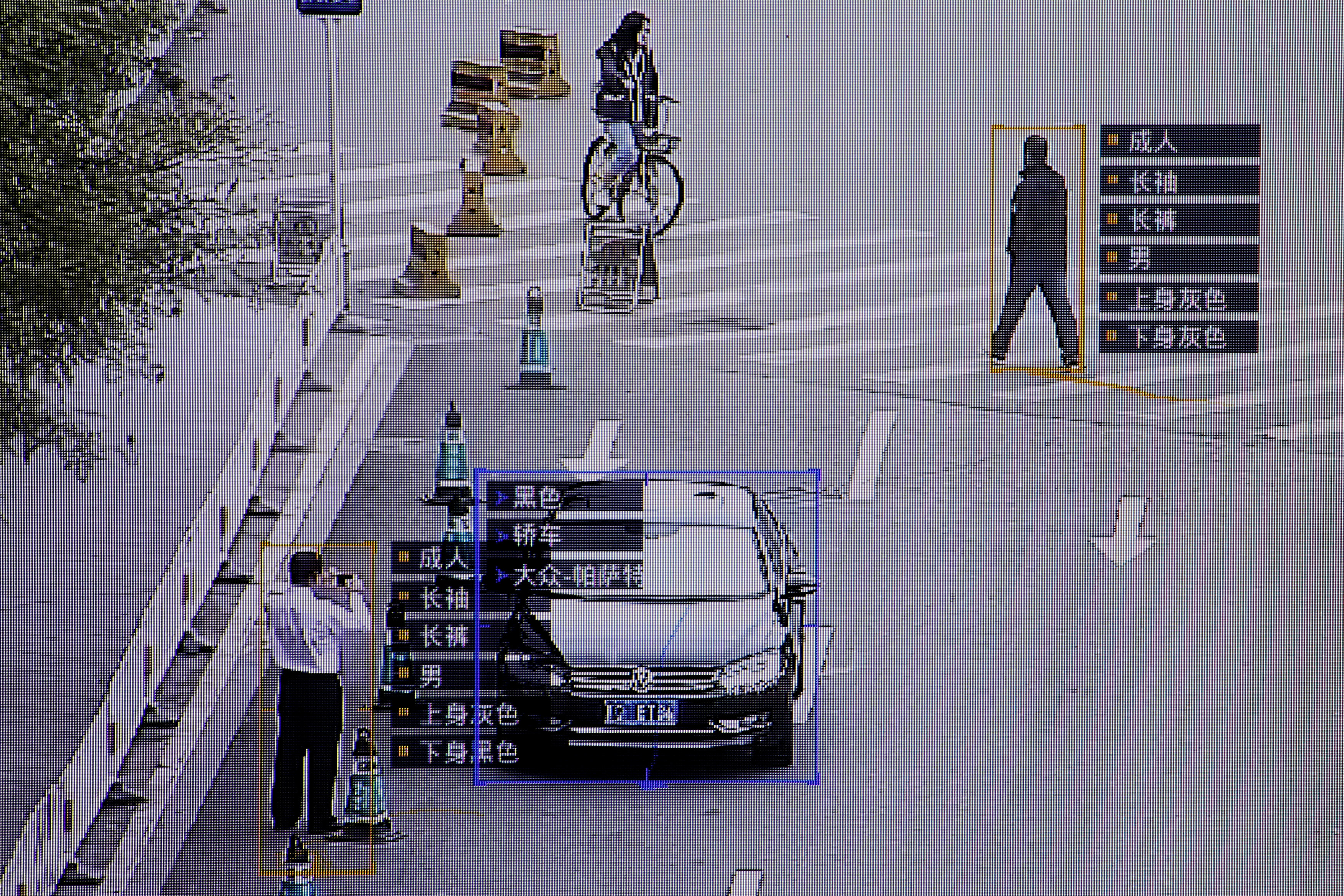 SenseTime surveillance software identifying details about people and vehicles runs as a demonstration at the company's office in Beijing