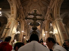 Members of the church hold a cross during a mass at the Santiago cathedral, in Santiago,