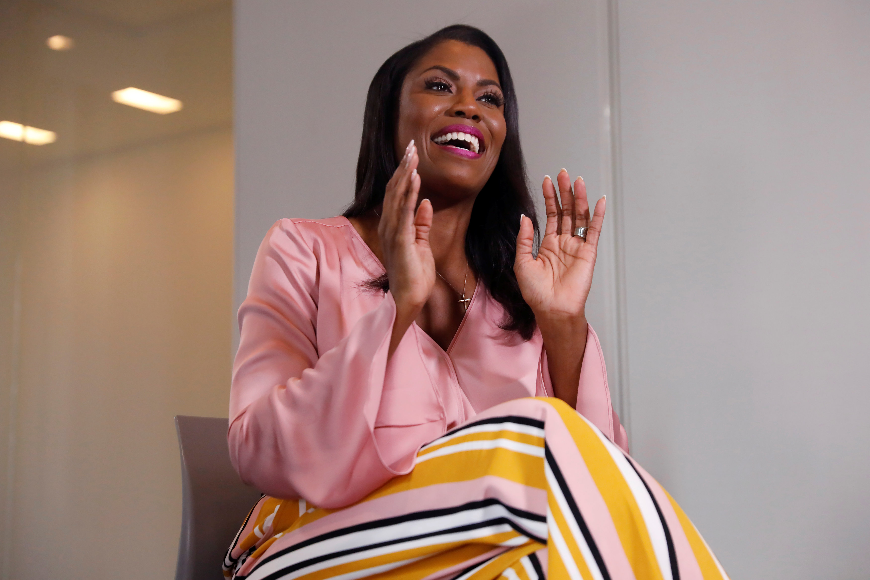 "Former U.S. White House staffer Omarosa Manigault-Newman gestures during an interview on the release of her book ""Unhinged"" in Manhattan, New York"