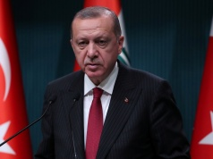 Turkish President Tayyip Erdogan attends a news conference in Ankara