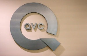 A QVC logo is displayed at the QVC Studio Park in West Chester, Pennsylvania