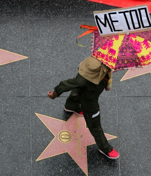A demonstrator takes part in a #MeToo protest march for survivors of sexual assault and their supporters in Hollywood
