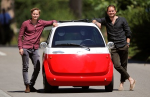 Oliver and Merlin Ouboter of Microlino AG pose beside an electric-powered Microlino car in Kuesnacht