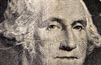 The image of the first U.S. President George Washington is seen on a dollar bill
