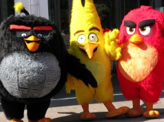 Angry Birds characters Bomb, Chuck and Red are pictured during the premiere in Helsinki, Finland