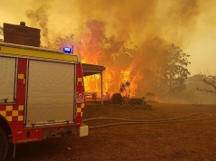 A fire engine is parked near bruing trees in New South Wales