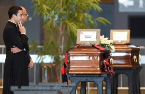 Coffins containing bodies of victims of the Genoa bridge collapse are seen at the Genoa Trade Fair and Exhibition Centre in Genoa
