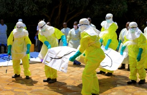Congolese officials and the World Health Organization officials wear protective suits as they participate in a training against the Ebola virus near the town of Beni