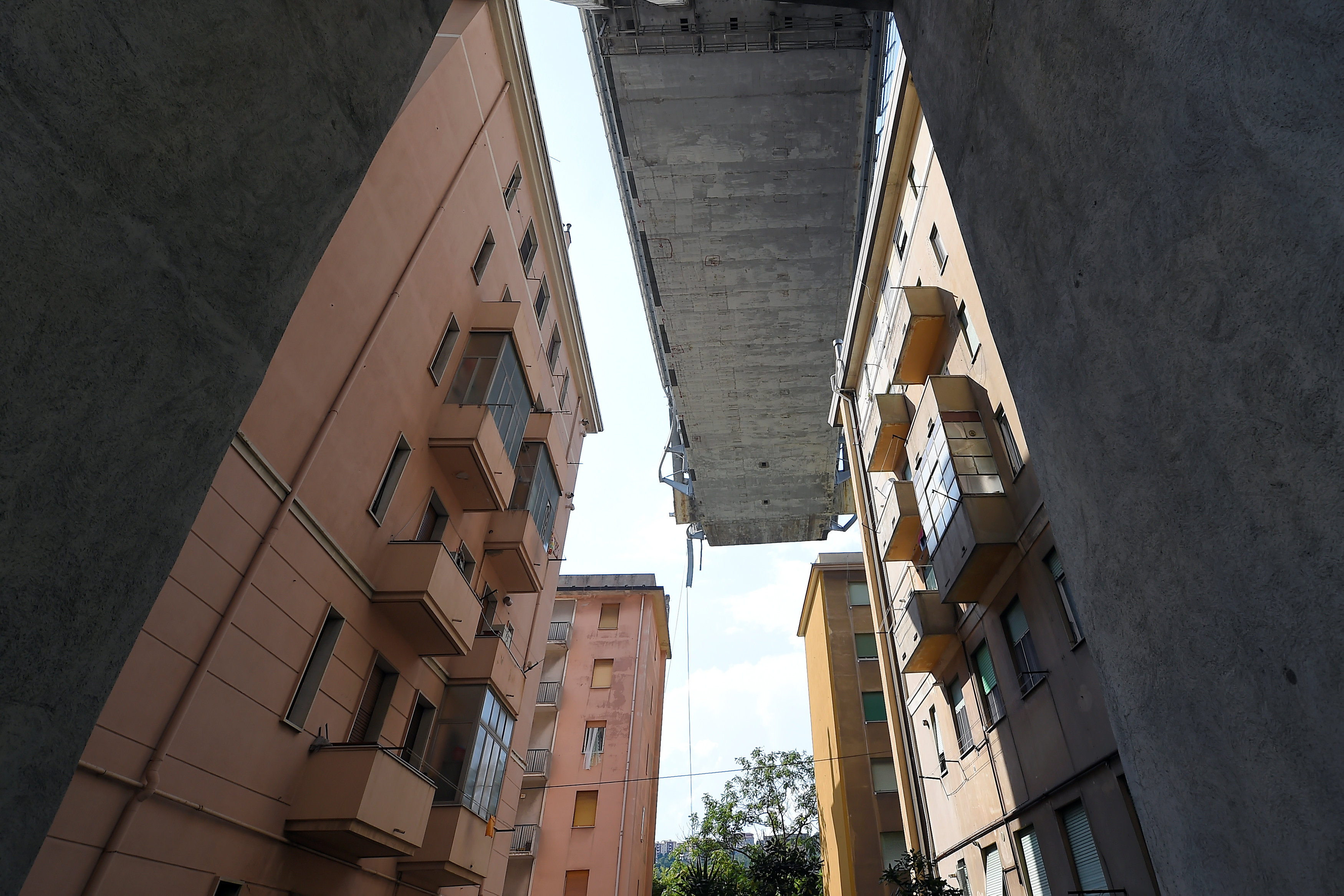 View of the collapsed Morandi Bridge and residential buildings seen from the red zone in Genoa