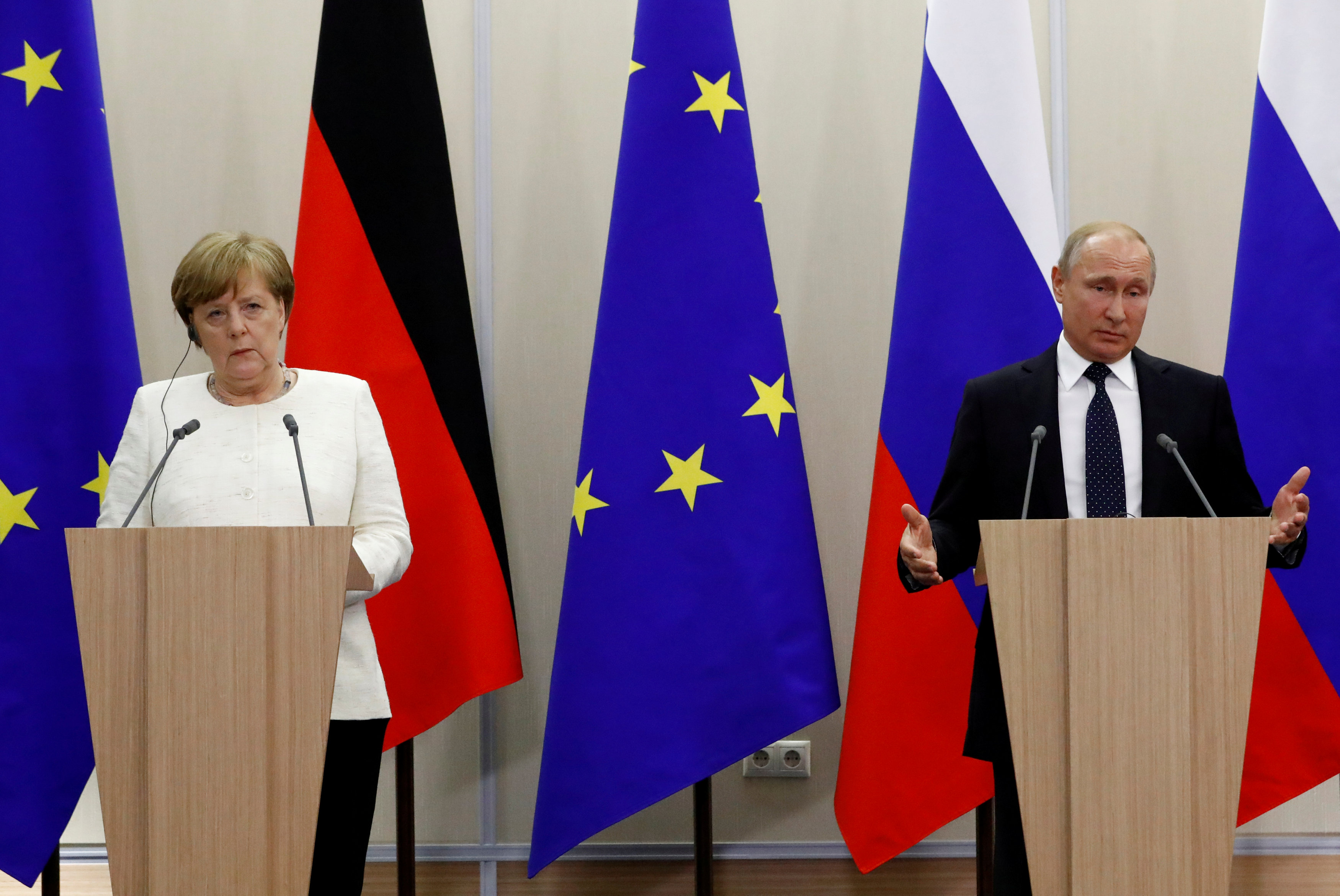 Russian President Putin and German Chancellor Merkel attend a joint news conference following their meeting in Sochi