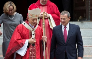 WU.S. Supreme Court Chief Justice John Roberts walks with Cardinal Donald Wuerl, archbishop of Washington, after attending the 64th Annual Red Mass at the Cathedral of St. Matthew the Apostle in Washington