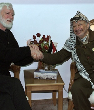 Palestinian President Yasser Arafat shakes hands with the head of Israeli peace delegation Uri Avneri in the West Bank City of Ramallah