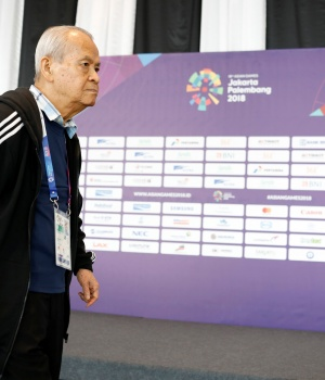 Philippinnes Bridge player Kong Te Yang walks before the start of the Men's Team Qualification Round againts Pakistan at the bridge competition at the Asian Games in Jakarta