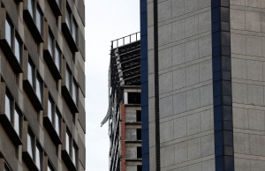 """Structural damage is seen on the top five floors of an abandoned 45-storey skyscraper known as the """"Tower of David"""" after an earthquake in Caracas"""