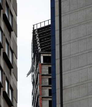 "Structural damage is seen on the top five floors of an abandoned 45-storey skyscraper known as the ""Tower of David"" after an earthquake in Caracas"