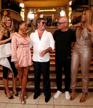 "Television producer Cowell poses with fellow judges from ""America's Got Talent"" Klum, Mel B, Mandel and host Banks after unveiling his star on the Hollywood Walk of Fame in Los Angeles"