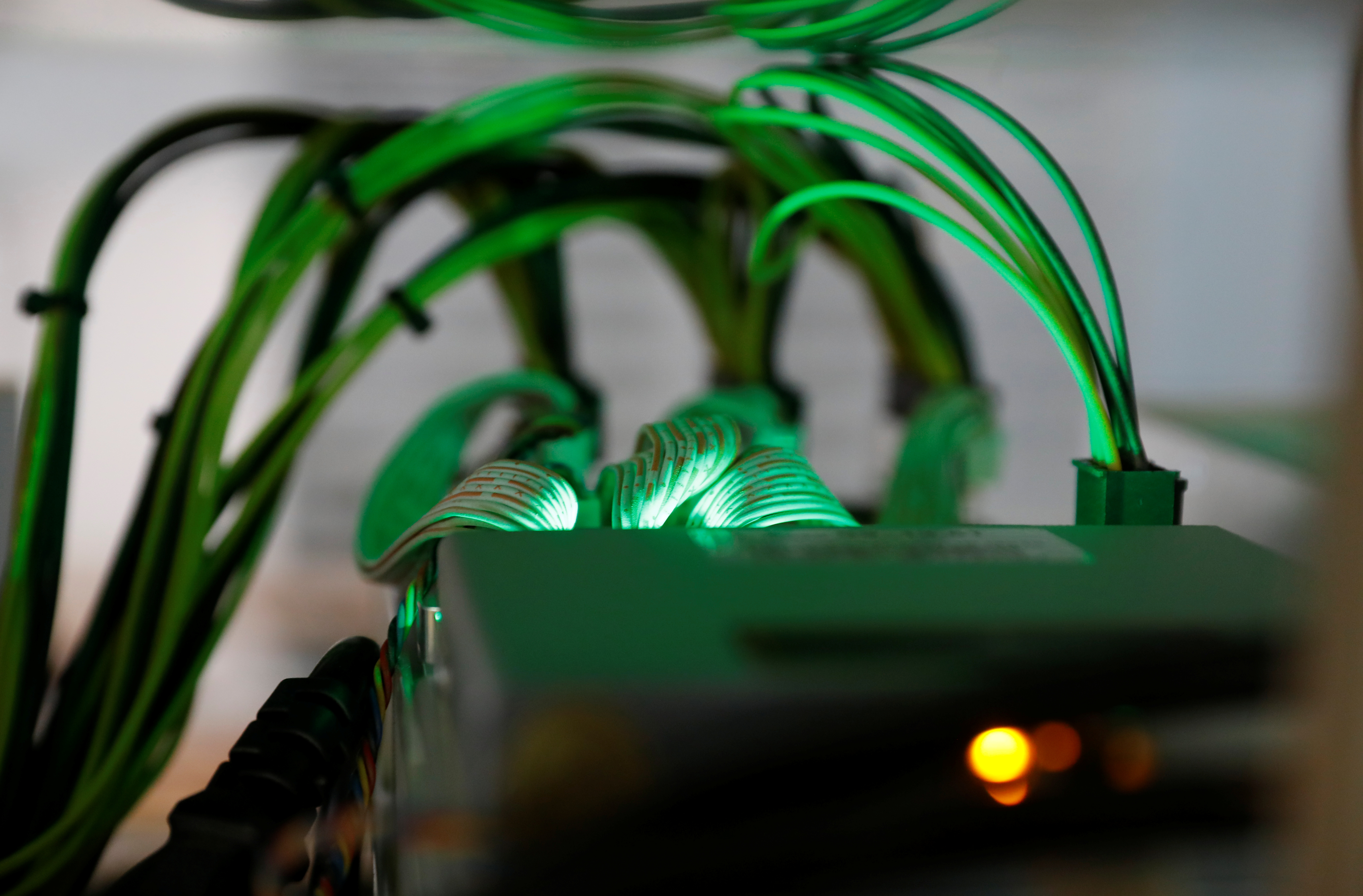 Cables running into cryptocurrency miners are seen at the HydroMiner cryptocurrency farming operation near Waidhofen an der Ybbs