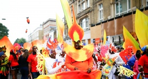 Revellers take part in the Notting Hill Carnival in London