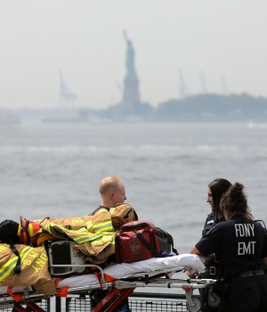 Emergency crews wait near the docking area for the Statue of Liberty after a fire broke out on Liberty Island forcing an evacuation in Manhattan, New York