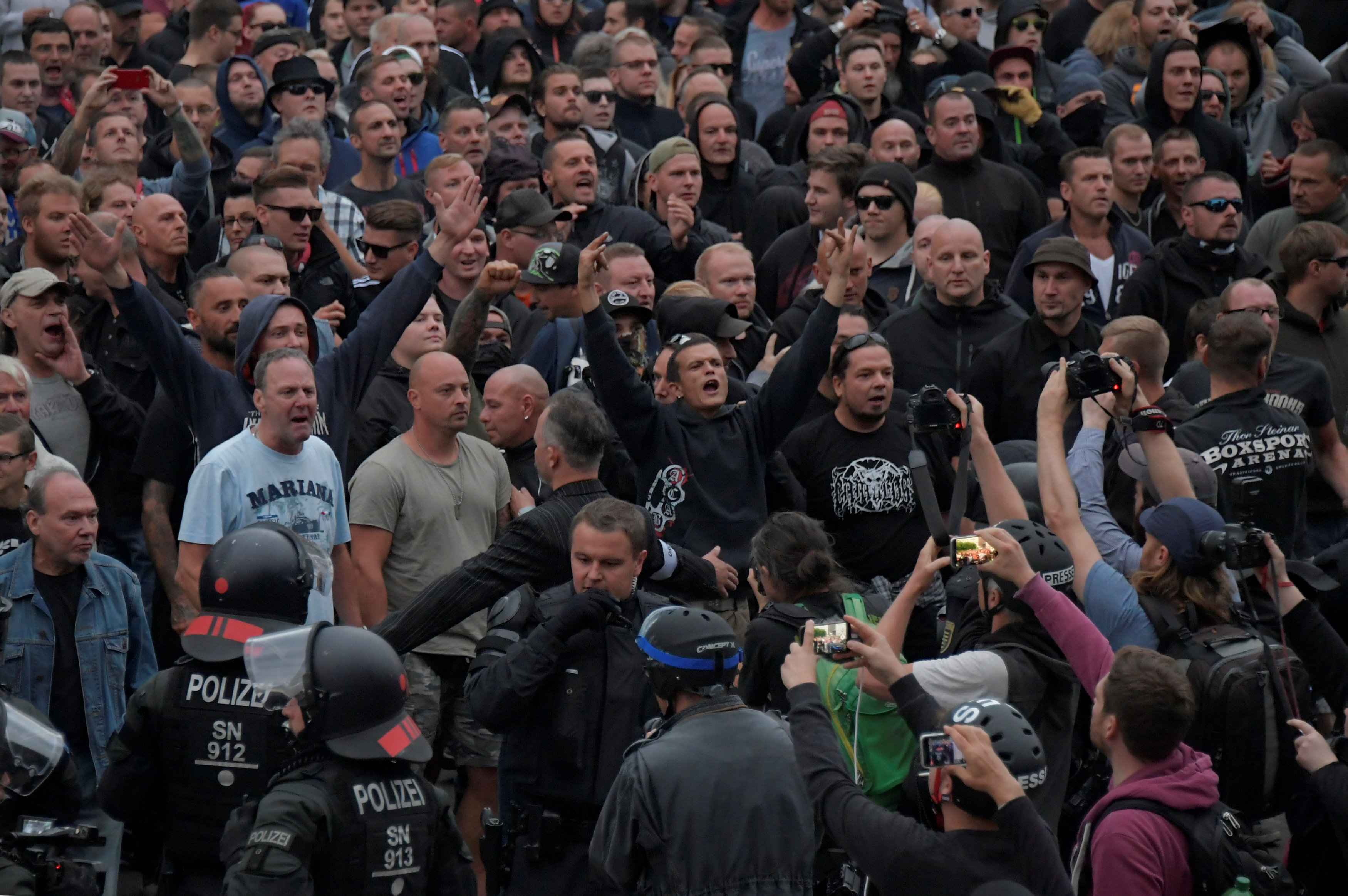 Right-wing supporters protest after a German man was stabbed last weekend in Chemnitz