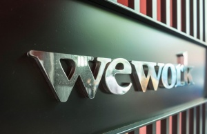 Logo of U.S. co-working firm WeWork is pictured during a signing ceremony in Shanghai