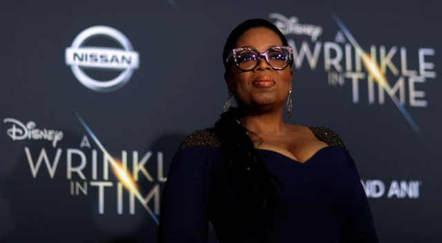 Cast member Winfrey poses at the premiere of
