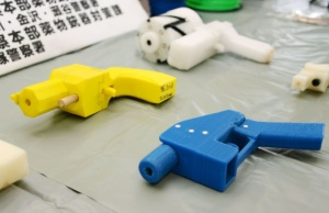 Seized plastic handguns which were created using 3D printing technology are displayed at Kanagawa police station in Yokohama, south of Tokyo