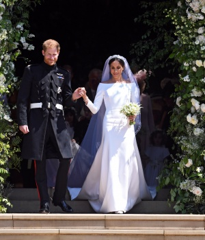 Britain's Prince Harry, Duke of Sussex and Meghan, Duchess of Sussex exit St George's Chapel in Windsor Castle after their royal wedding ceremony, in Windsor.