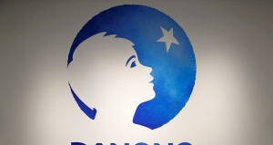 The logo of French food group Danone is pictured during the company's 2017 annual results in Paris
