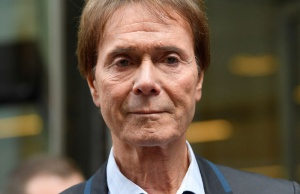 Singer Cliff Richard leaves the High Court after the court found in his favour in the privacy case he brought against the BBC, in central London