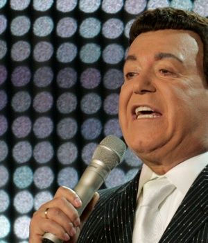 Soviet crooner Iosif Kobzon of Russia performs as an invited guest during the opening show of the New Wave international song contest in Jurmala