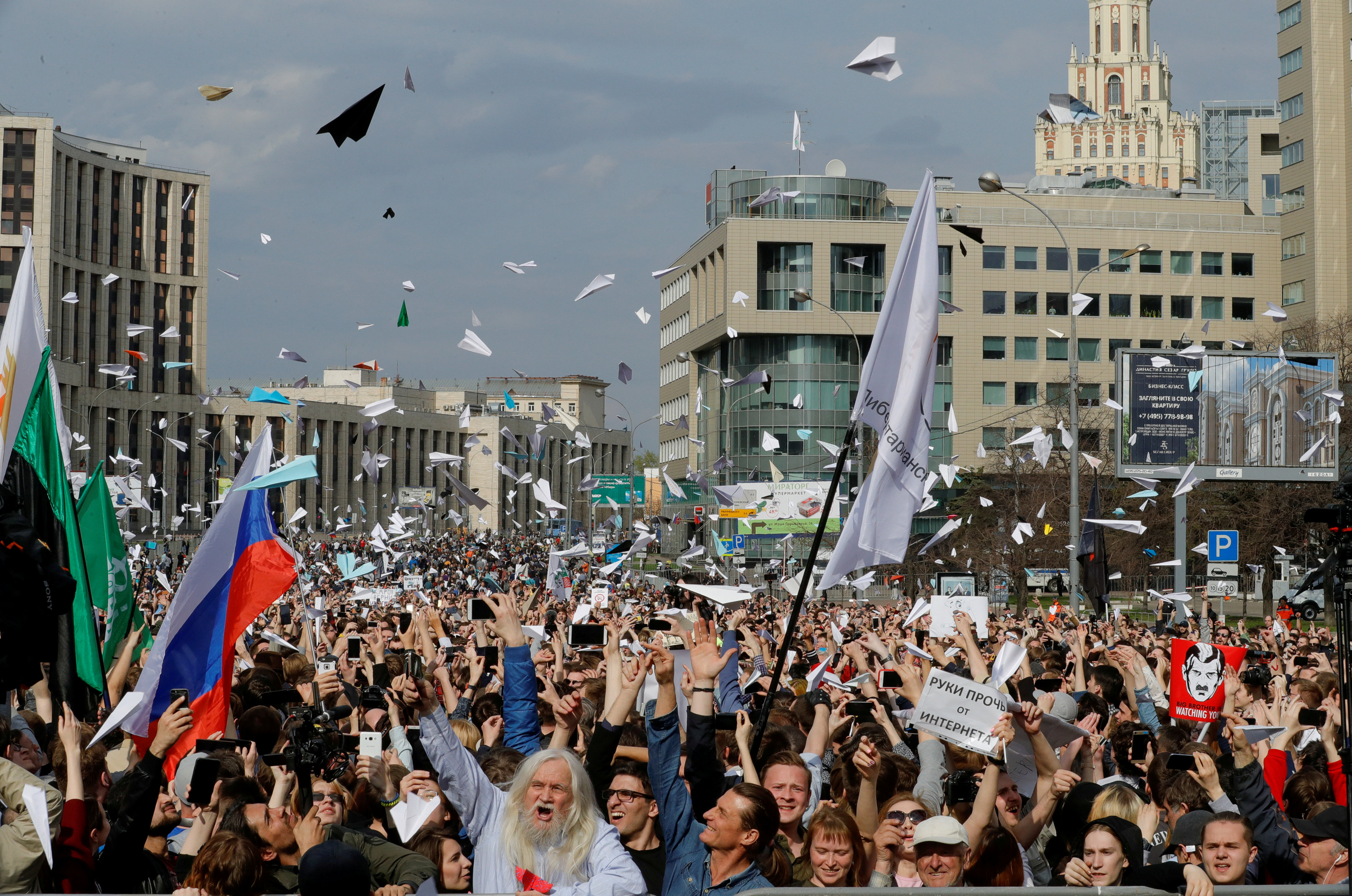People release paper planes, symbol of the Telegram messenger, during a rally in protest against court decision to block the messenger because it violated Russian regulations, in Moscow