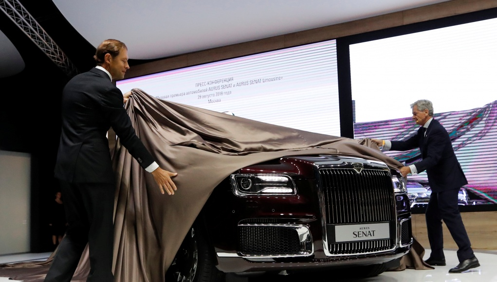 Russian Industry Minister Manturov and Aurus CEO Hilgert make the world premiere of the Aurus Senat at the 2018 Moscow International Auto Salon in Moscow