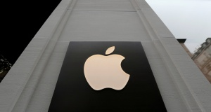 The company's logo is seen outside Austria's first Apple store during a media preview in Vienna