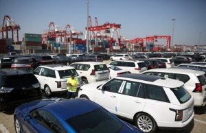 Worker inspects imported cars at a port in Qingdao