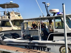 Mohave County Sheriff's Office search and rescue boats look for four people missing on the Colorado River, north of Lake Havasu in Arizona