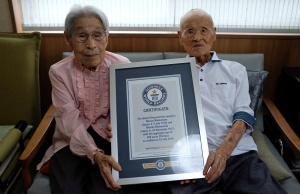 World's oldest living married couple Masao Matsumoto and Miyako Matsumoto poses with the Guinness World Record certificate at a nursing house in Takamatsu