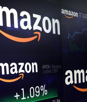 The Amazon.com logo and stock price information is seen on screens at the Nasdaq Market Site in New York City