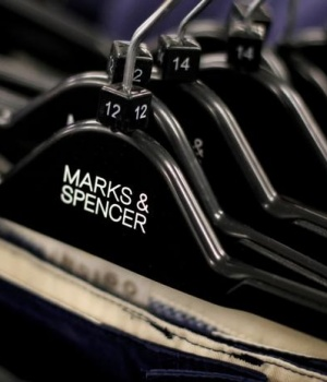 File photo of clothes displayed on hangers in an Marks & Spencer shop in northwest London