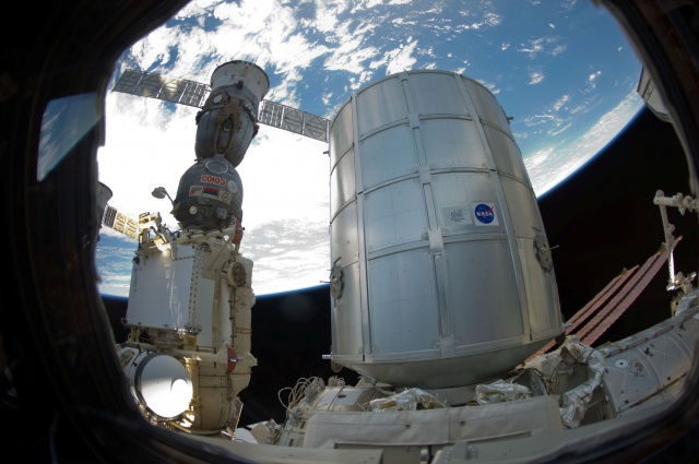NASA handsout of the newly-attached Permanent Multipurpose Module and a docked Russian Soyuz spacecraft