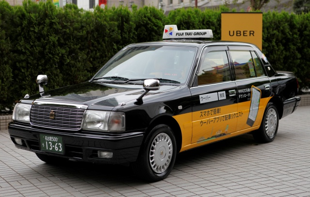 A taxi operated by Fuji Taxi Group bearing an Uber Japan ad is pictured in Nagoya
