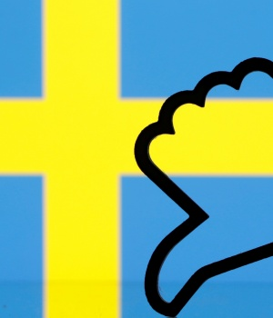 "3-D printed Facebook ""Like"" is seen in front of displayed Sweden flag in this illustration picture"