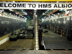 Military vehicles are seen in the loading dock of the HMS Albion, the British Royal Navy flagship amphibious assault ship, after the ship's arrival at Harumi Pier in Tokyo